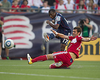 New England Revolution midfielder Sainey Nyassi (17) passes the ball as Chicago Fire defender Gonzalo Segares (13) defends. In a Major League Soccer (MLS) match, the New England Revolution tied the Chicago Fire, 1-1, at Gillette Stadium on June 18, 2011.