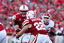 10 Sept 2011: Quarterback Taylor Martinez #3 of the Nebraska Cornhuskers hands the ball off to runningback Rex Burkhead #22 at Memorial Stadium in Lincoln, Nebraska. Nebraska defeated Fresno State 42 to 29.