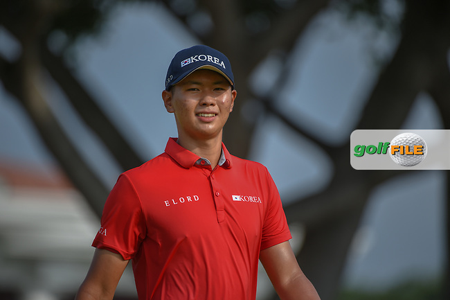 Jin-Bo HA (KOR) smiles as he heads down 12 during Rd 2 of the Asia-Pacific Amateur Championship, Sentosa Golf Club, Singapore. 10/5/2018.<br /> Picture: Golffile | Ken Murray<br /> <br /> <br /> All photo usage must carry mandatory copyright credit (© Golffile | Ken Murray)