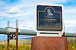 The memorial of E.L. Patton Bridge along Dalton Hwy. The Alaska pipeline is in the background. Arctic Alaska, Autumn.
