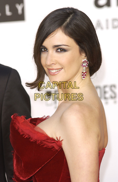 PAZ VEGA.Arrives at the amfAR Cinema Against AIDS 2005, held during the 58th Cannes International Film Festival, Cannes, France, May 19th 2005..half length red velvet dress bow strapless earrings dangly stones jewels diamond.Ref: FIN.www.capitalpictures.com.sales@capitalpictures.com.©Steve Finn/Capital Pictures.