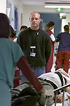 Shawn Whitney A chaplain intern at San Francisco General Hospital praise for particular patients that are admitted in the emergency room during a very busy evening.