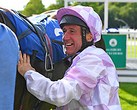 Jockey John Egan unsaddles Dark Optimist in the Winners enclosure after winning The George Smith Horseboxes British EBF Maiden Stakes   during Evening Racing at Salisbury Racecourse on 25th May 2019