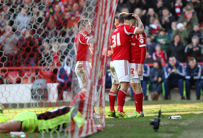 Nottingham Forest's Simon Cox celebrates scoring his sides first goal  as  Yeovil Town's Marek Stech lies beaten<br /><br />Photo by Mick Walker/CameraSport<br /><br />Football - The Football League Sky Bet Championship - Nottingham Forest v Yeovil Town - Sunday 2nd February 2014 - The City Ground - Nottingham<br /><br />&copy; CameraSport - 43 Linden Ave. Countesthorpe. Leicester. England. LE8 5PG - Tel: +44 (0) 116 277 4147 - admin@camerasport.com - www.camerasport.com