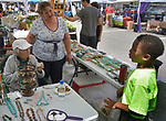 Matriarch of the Kreda family, Sallie Kreda, along withbooth operator, Linda, talking with young vender, Amitai Lewis, who was visiting at the Grey Mouse Farm booth at the Saugerties Farmer's Market on Main Street in the Village of Saugerties, NY, on Saturday, June 10, 2017. Photo by Jim Peppler. Copyright/Jim Peppler-2017.