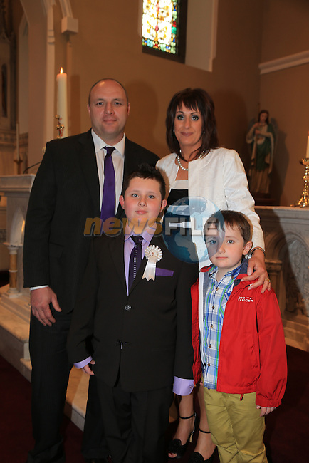James Briscoe and Jack Briscoe with Martain and Nicola.at First Comunion in Termonfeckin church..Picture:  www.newsfile.ie ..