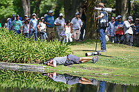 A photographer gets low to get that perfect reflection shot on 6 during round 1 of the World Golf Championships, Mexico, Club De Golf Chapultepec, Mexico City, Mexico. 2/21/2019.<br /> Picture: Golffile | Ken Murray<br /> <br /> <br /> All photo usage must carry mandatory copyright credit (© Golffile | Ken Murray)