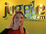 "CrowdSource CEO Stephanie Leffler in front of the ""Juggle.com"" sign - the corporate owner of the Swansea-based content and SEO business.  CrowdSource recently bought out one of their top competitors, San Francisco-based Servio."