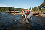 Volunteers at the Great Willamette Cleanup picking up trash near Milwaukie Oregon