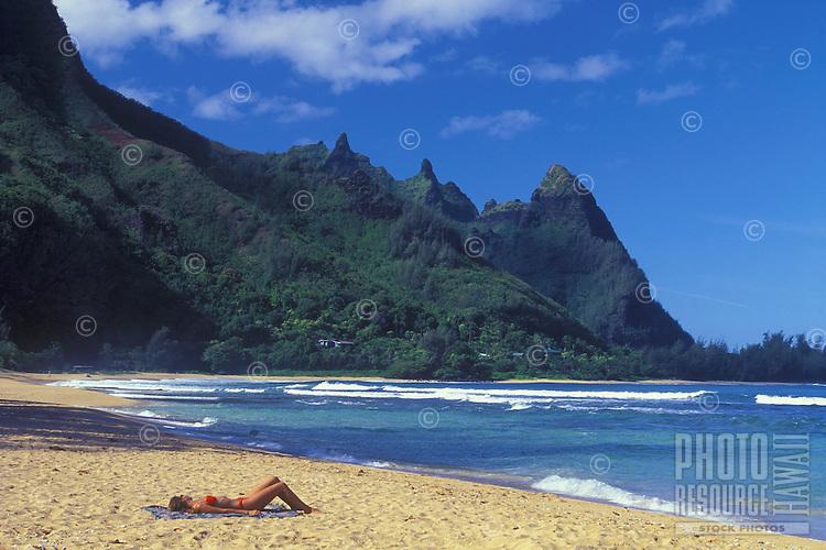 Woman enjoys the beach at Tunnels, Kauai, Hawaii, USA.