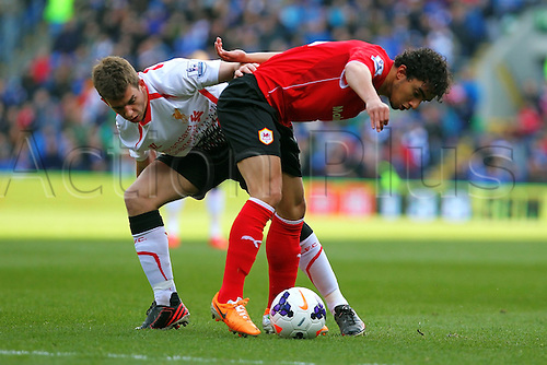 22.03.2014  Cardiff, Wales. Fabio Da Silva of Cardiff City and Jon Flanagan of Liverpool  in action during the Premier League game between Cardiff City and Liverpool from Cardiff City Stadium.