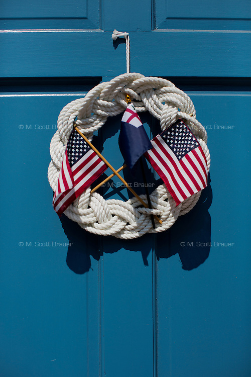 A patriotic decoration hangs on a door in Charlestown, Boston, Massachusetts, USA.