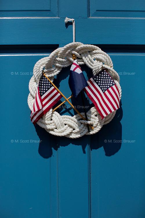 A patriotic decoration hangs on a door in Charlestown, Boston, Massachusetts, USA.