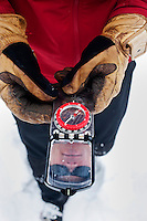 Colorado Avalanche Information Center (CAIC) Avalanche Forecaster Tim Brown (cq) finds his location using a compass at Coon Hill, which stands about 11,150 feet in elevation, near Summit County in Colorado, Thursday, February 16, 2012. Tests at this area showed that there was a fairly hard slab of snow resting on weaker snow beneath making conditions which can lead to avalanches...Photo by Matt Nager