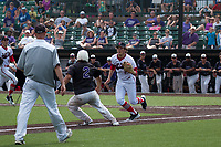 Hayden Hirschvogel tries to tag out a Fort Zumwalt West baserunner in the top of the eighth-inning.