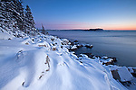 Fresh snow coats the rocky shoreline on the east side of the Schoodic Peninsula, Acadia National Park, Maine