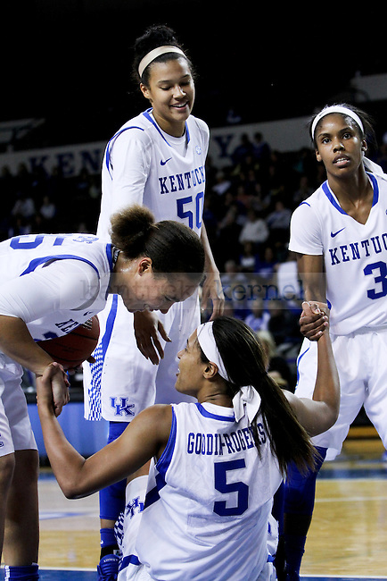 Makayla Epps, Azia Bishop and Janee Thompson help sophomore forward Kyvin Goodin-Rogers off the floor during the first half of the UK Hoops vs Pikeville at Memorial Coliseum in Lexington. KY., on Thursday, November 4, 2014. Photo by Jonathan Krueger | Staff