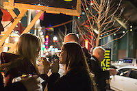 "Matt Fay (hat), Nick Fay (shaved head), Ali Glass (brown hair), and Emily Long (blond), eat hotdogs from a street vendor across Lansdowne Street from Fenway Park in Boston, Massachusetts, USA, in the early hours of Saturday, Dec. 5, 2015. The group had been at the Yard House sports bar and made a stop to get a bite to eat before heading to the Back Bay area of Boston for another bar. Matt Fay said, ""These are the best hot dogs in Boston."""