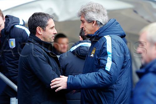 05.03.2016. The Etihad, Manchester, England. Barclays Premier League. Manchester City versus Aston Villa. Aston Villa Manager Remi Garde shakes hands with Manchester City Manager Manuel Pellegrini