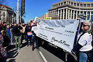 Washington, DC - March 24, 2018: Marchers hold a simulated check from the NRA to congress as hundreds of thousands of people gather in Washington, DC for the national March for Our Lives Rally, March 24, 2018.  (Photo by Don Baxter/Media Images International)