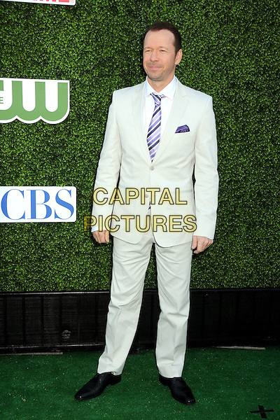 DONNIE WAHLBERG.CBS Summer Press Tour Party 2010 held at The Tent, Beverly Hills, California, USA..July 28th, 2010.full length suit white grey gray purple blue stripe.CAP/ADM/BP.©Byron Purvis/AdMedia/Capital Pictures.