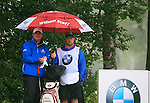 Paul Lawrie (SCO) and his caddy shelter from the rain on the 6th tee during Day 1 of the BMW International Open at Golf Club Munchen Eichenried, Germany, 23rd June 2011 (Photo Eoin Clarke/www.golffile.ie)