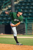 Augusta GreenJackets starting pitcher Christian Jones (23) follows through on his delivery against the Hickory Crawdads at L.P. Frans Stadium on May 11, 2014 in Hickory, North Carolina.  The GreenJackets defeated the Crawdads 9-4.  (Brian Westerholt/Four Seam Images)