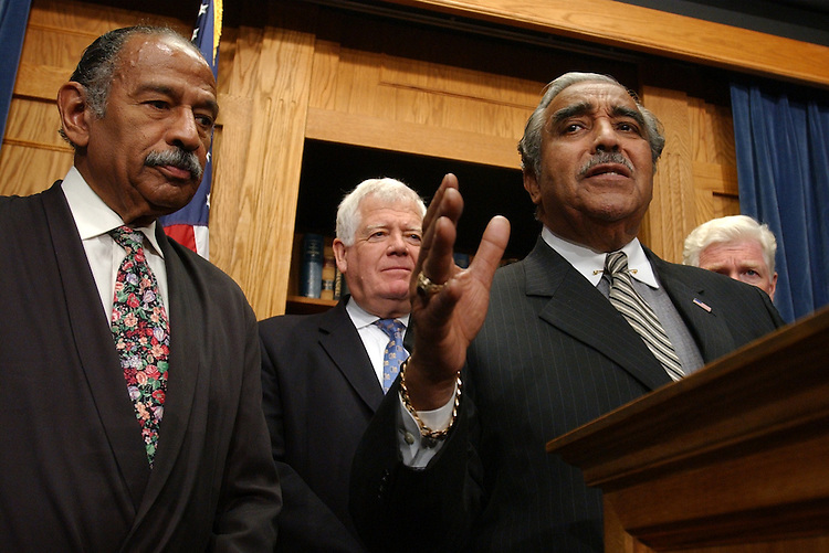 From left, Reps. John Conyers, Jim McDermott, D-Wash., Charlie Rangel, D-N.Y., and Jim Moran, D-Va., attend a news conference on the possibility of the military draft.