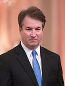 Associate Justice of the Supreme Court Brett Kavanaugh listens as United States President Donald J. Trump makes remarks as he hosts a ceremonial swearing-in ceremony for Kavanaugh in the East Room of the White House in Washington, DC on Monday, October 8, 2018.  Kavanaugh formally took the oath on Saturday, hours after he was confirmed by the US Senate. <br /> Credit: Ron Sachs / CNP<br /> (RESTRICTION: NO New York or New Jersey Newspapers or newspapers within a 75 mile radius of New York City)