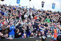 Bath Rugby supporters in the crowd celebrate a try. Aviva Premiership match, between Bath Rugby and Sale Sharks on April 23, 2016 at the Recreation Ground in Bath, England. Photo by: Patrick Khachfe / Onside Images