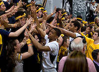 Tyrone Wallace of California and Richard Solomon of California celebrate with the fans after winning the game against Oregon State Beavers at Haas Pavilion in Berkeley, California on January 31st, 2013.  California defeated Oregon State, 71-68.
