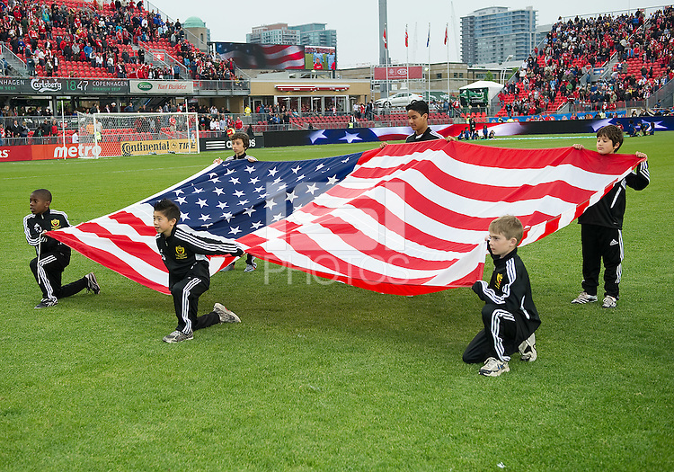 The US flag during the opening ceremonies in an MLS game between Sporting Kansas City and the Toronto FC at BMO Field in Toronto on June 4, 2011..The game ended in a 0-0 draw...