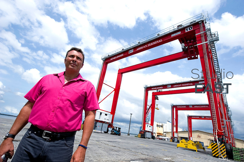 Abidjan Terminal Technical Director Eric Codron poses for a photograph in front of four new KoneCranes RTG cranes being assembled in Abidjan Container Terminal, in Abidjan, Ivory Coast, on November 3, 2010. Eric Codron works for Bolloré group. Photo by Lucas Schifres/Pictobank