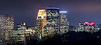 Minneapolis skyline at night from Cedar Lake Parkway.