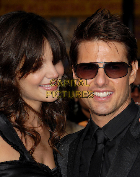KATIE HOLMES & TOM CRUISE.Paramount Pictures' Fan Screening of Mission: Impossible III held at The Grauman's Chinese Theatre in Hollywood, California, USA..May 4th, 2006.Ref: DVS.headshot portrait sunglasses shades celebrity couple.www.capitalpictures.com.sales@capitalpictures.com.Supplied By Capital PIctures