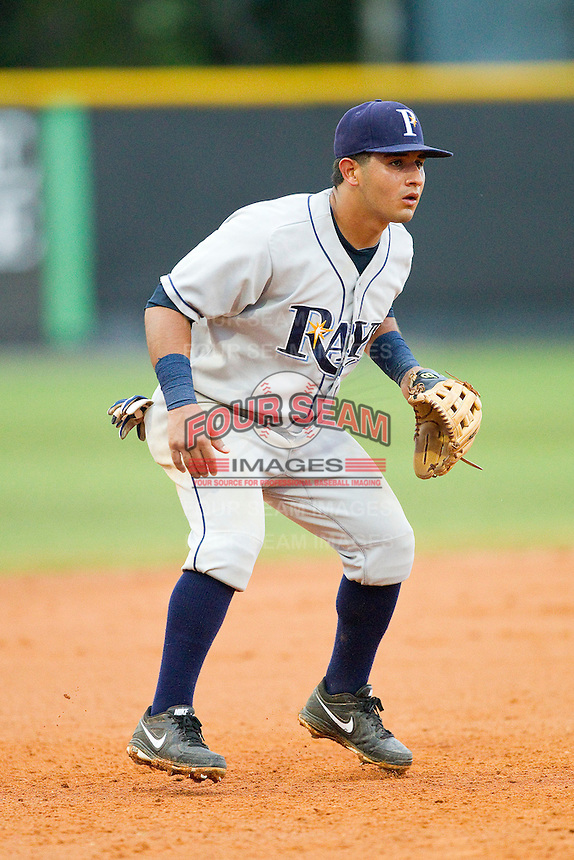 Princeton Rays third baseman David Garcia (24) on defense against the Burlington Royals at Burlington Athletic Park on July 5, 2013 in Burlington, North Carolina.  The Royals defeated the Rays 5-4 in game two of a doubleheader.  (Brian Westerholt/Four Seam Images)