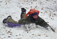 An unidemtified bpy sleds at the Michener Museum, Thursday, December 5, 2002 in Doylestown, Pennsylvania. The Philadelphia region was expecting 4-6 inches of snow from it's first major winter storm in two years. (Photo by William Thomas Cain/photodx.com)