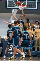 WASHINGTON, DC - FEBRUARY 8: Mekhi Long #15 of Rhode Island goes high to block a shot by Chase Paar #3 of George Washington during a game between Rhode Island and George Washington at Charles E Smith Center on February 8, 2020 in Washington, DC.