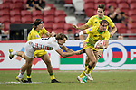 John Porch of Australia runs with the ball while Harry Glover of England (left) tries to stop him during the match Australia vs England, the Bronze Final of Day 2 of the HSBC Singapore Rugby Sevens as part of the World Rugby HSBC World Rugby Sevens Series 2016-17 at the National Stadium on 16 April 2017 in Singapore. Photo by Victor Fraile / Power Sport Images