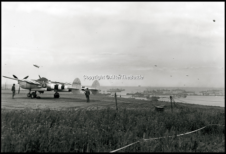 BNPS.co.uk (01202 558833)<br /> Pic: AfterTheBattle/BNPS<br /> <br /> 'Somewhere in France' This historic picture shows 'the first American aircraft to land in France after D-Day' - The P-38 Lightning is clearly still very close to the invasion beaches.<br /> <br /> A fascinating new book reveals how countless allied airfield's sprang up across the Normandy battlefields post D-day, and were a key element in defeating the Nazi war machine.<br /> <br /> Without a public enquiry or impact statement in sight the Allies constructed paved airstrips as fast as they could to allow the RAF's fighters and bombers to operate in close support of the ground troops.<br /> <br /> Amazingly these bases were thrown up in days and would then sometimes be abandoned just weeks later as the front crept eastward towards Germany.<br /> <br /> Today hardly any mark has been left in the landscape to show where they were briefly situated during 1944.