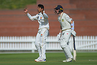 Wellington's Rachin Ravindra (left) and Otago's Camden Hawkins during day two of the Plunket Shield cricket match between the Wellington Firebirds and Otago Volts at the Basin Reserve in Wellington, New Zealand on Tuesday, 22 October 2019. Photo: Dave Lintott / lintottphoto.co.nz