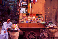 Egypt. Luxor. Herb and tea trader sat outside his shop.