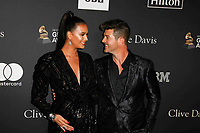 BEVERLY HILLS, CA- FEBRUARY 09: April Love Geary and Robin Thicke at the Clive Davis Pre-Grammy Gala and Salute to Industry Icons held at The Beverly Hilton on February 9, 2019 in Beverly Hills, California.      <br /> CAP/MPI/IS<br /> &copy;IS/MPI/Capital Pictures