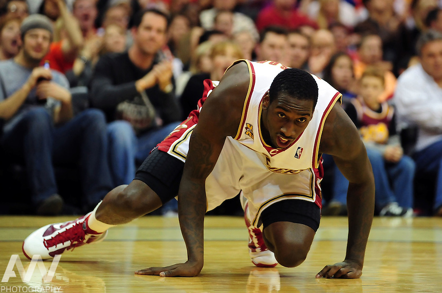 Dec 27, 2009; Cleveland, OH, USA; Cleveland Cavaliers forward J.J. Hickson (21) tumbles on the court during the third quarter against the Houston Rockets at Quicken Loans Arena. Mandatory Credit: Andrew Weber-US PRESSWIRE..