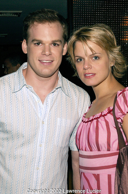 NEW YORK-AUGUST 6: Actor Michael C. Hall and his wife, actress Amy Spanger, arrive at the after party for her debut in the Broadway musical Chicago August 6, 2002, in New York City.