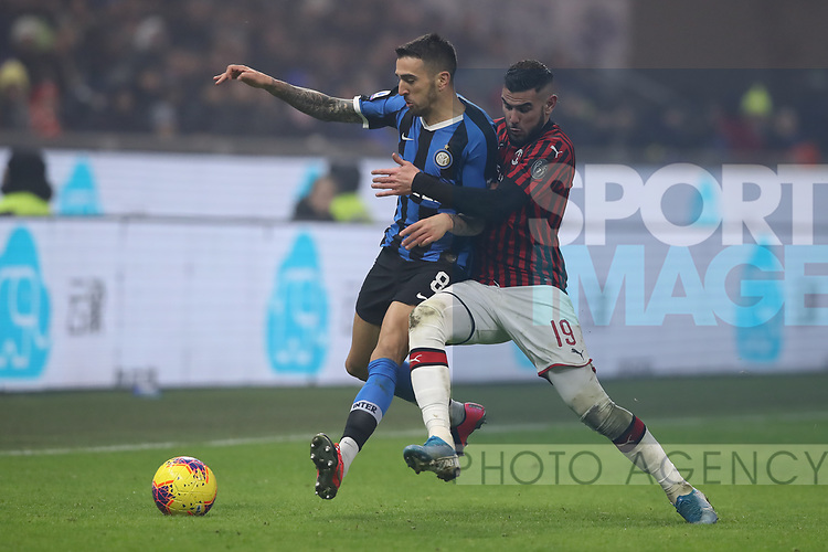 Matias Vecino of Inter receives a push in the back from Theo Hernandez of AC Milan during the Serie A match at Giuseppe Meazza, Milan. Picture date: 9th February 2020. Picture credit should read: Jonathan Moscrop/Sportimage