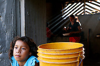 Maria Fernandez waits for lunch in her neighbor's kitchen in El Trepiche, Nicaragua, on Wednesday, June 28, 2006. (Photo by Bryce Yukio Adolphson/Brooks Institute of Photography, &copy; 2006)<br />