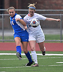 Roxana forward Emma Lucas (16, left) gets a shot off and scores the fourth goal for her team  even while closely guarded by Freeburg defender Claudia Etling in second half action. Roxana High School played a girls soccer game at Freeburg High School on Thursday May 3, 2018. Tim Vizer | Special to STLhighschoolsports.com