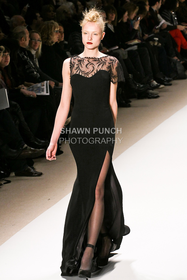 Aida walks the runway in a black crepe gown with Chantilly lace single sleeve, by Georges Chakra for the Edition Autumn Winter 2010-2011 collection, during Mercedes-Benz Fashion Week Fall 2010.