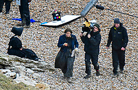 BNPS.co.uk (01202 558833)<br /> Pic: Graham Hunt/BNPS<br /> <br /> Light, Camera...Pastie time - Kate Winslet and Saoirse Ronan filming a scene on the Beach at Eype near Bridport in Dorset yesterday for the controversial new film Ammonite about the life of fossil hunter Mary Anning.
